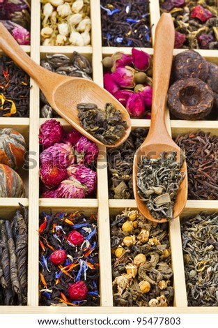 different tea types : green, black, china, floral , herbal  in a wooden box with bamboo spoons