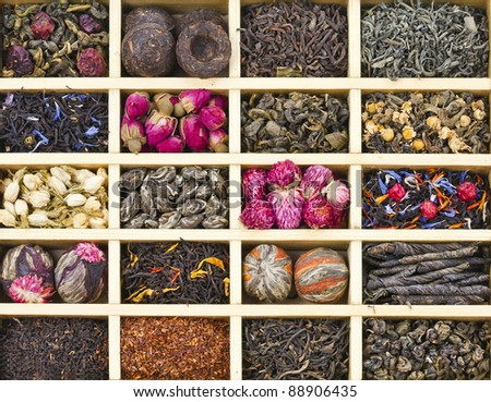 different tea types : green, black, floral , herbal in a wooden box background