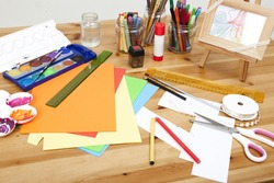 different things lying on a table to try arts and crafts, background white