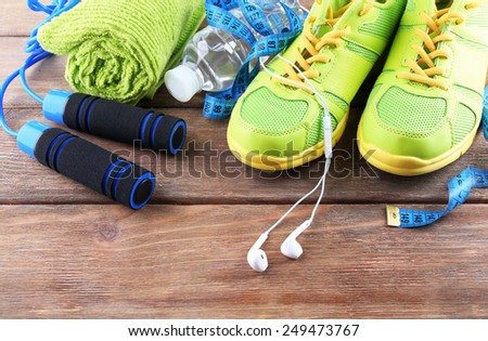 Different tools for sport on wooden background