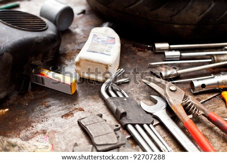 Different tools in a dirty workshop