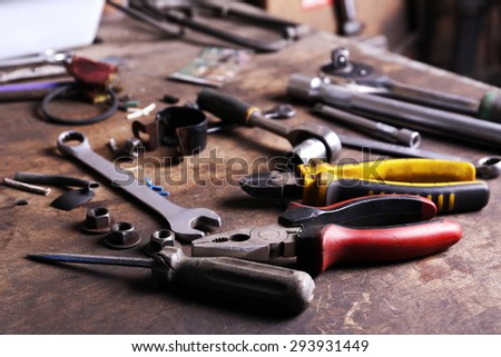 Different tools on workplace in garage