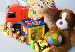Different toys on a gray background