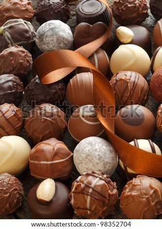Different Truffles with a brown ribbon as a closeup