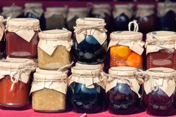 Different type of homemade jams from various berry raspberry, blackberry, apricots, rhubarb, apples, gooseberries, black currants. Side hustles at home concept – image