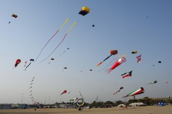 Different Type Of Kites Flying In The Sky On A Beach During Halla February Kuwait Kite Festival