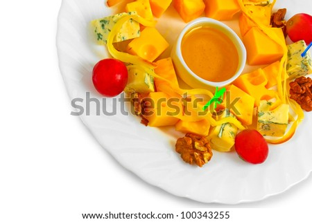 Different types cheese appetizer with honey, nuts and grapes on a plate isolated on white background