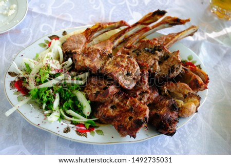 Different types of Azeri kababs served with onions and sumac in Agsu region of Azerbaijan