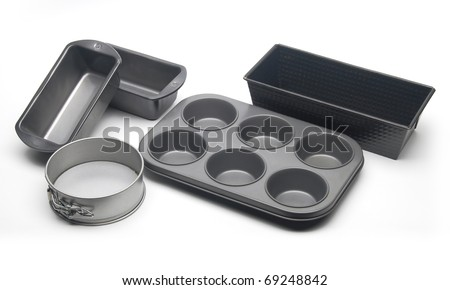 Different types of baking pans and moulds for cake, bread and muffins.