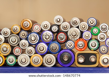 Different types of batteries arranged in a stack