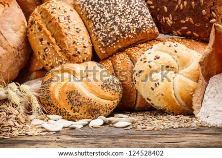 Different types of bread on wooden table