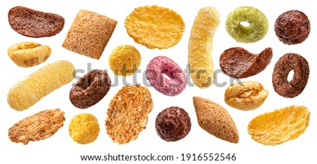 Different types of breakfast cereals isolated on white background, sweet cornflakes, chocolate pads and rings, puffed rice and wholegrain flakes collection Сток-фото ©