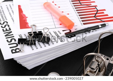 Different types of charts, documents business with a green pen and red highlighter pen