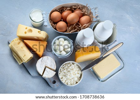 Different types of fresh farm dairy products. Foods rich in Calcium. Top view  Foto stock ©