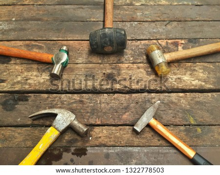 Different types of hammers: sledge hammers, ball peen hammer, chipping hammer, regular claw hammer. #1322778503