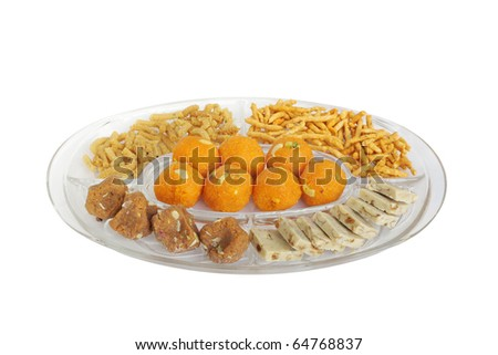 Different Types Of Indian Sweets And Snacks Kept In A Plate Stock ...