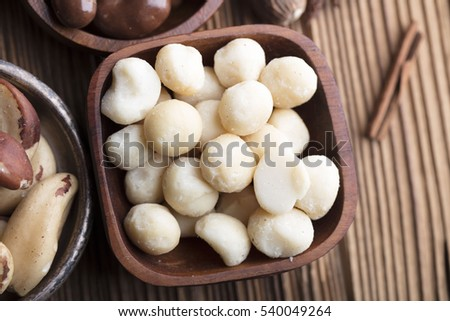 Different types of nuts: walnut, hazelnut, cashew, peanuts; brazil , pine and other. Almonds, walnuts and hazelnuts in wooden bowls on wooden background. #540049264