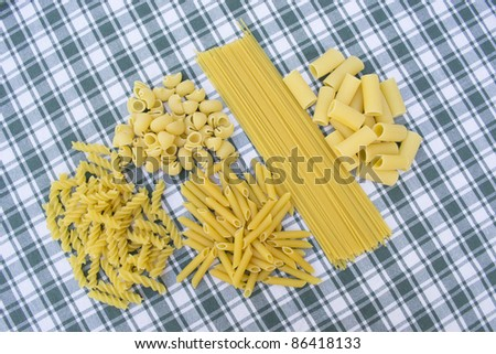 different  types of pasta on a checkered cloth