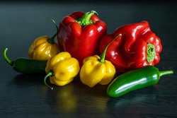 Different types of peppers: habanero, sweet pepper, oblong hot pepper