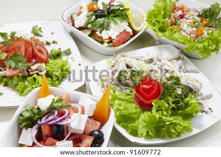 Different types of vegetable and seafood salads