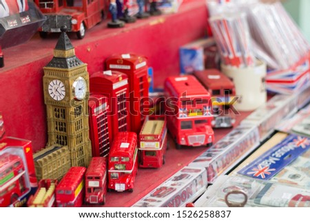 Different typical souvenirs of England exhibited in a market stall