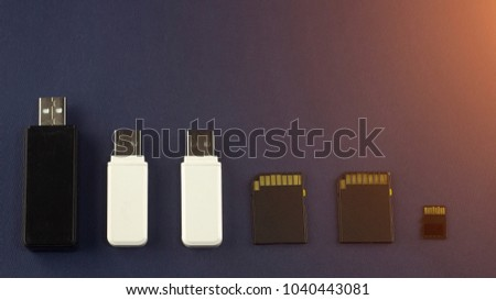 Different USB flash drives and memory cards on a blue background