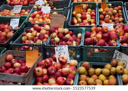 Different varieties of apples for sale at one of the markets in Warsaw, Poland. Horizontal composition.