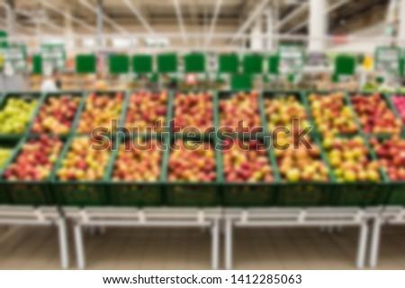 different varieties of apples in the window blur