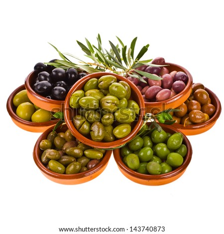 different varieties of olives marinated in traditional clay bowls decorated with branches of olive tree isolated on white background