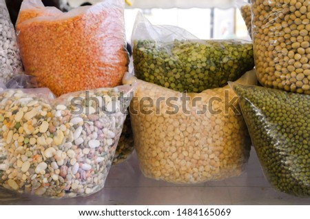 Different varieties of peas, beans and lentils in the street market