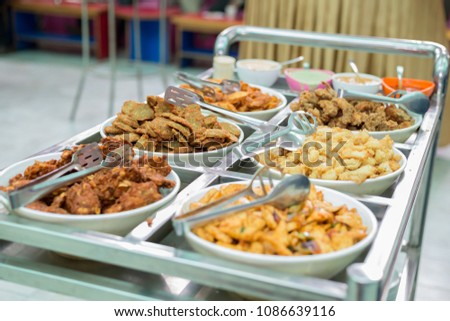Different Varieties of Snacks,Food on Trolly at Banquet to serve at the wedding reception.