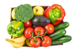 Different vegetables, fruits in cardboard box on white, top view. Healthy vegetarian food. Food donation, online shopping or contactless delivery service concept. Avocado, pepper, tomato and broccoli