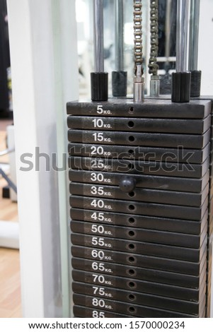 Different weights in kilograms in a multipower machine in the gym.