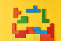 Different wooden blocks on a yellow background. Concept of logical thinking and education
