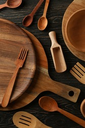 Different wooden kitchenware on wooden table, top view