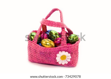 differnt easter chocolate eggs in a pinkl bag isolated on white background