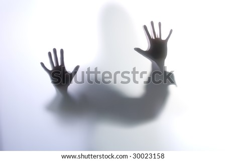Diffused Silhouette of a woman's body through frosted glass
