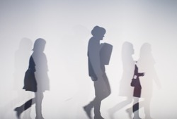 diffused silhouette of people through white cloth