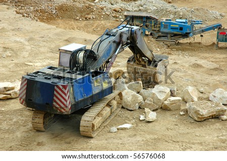 digger in quarry - open-pit mine