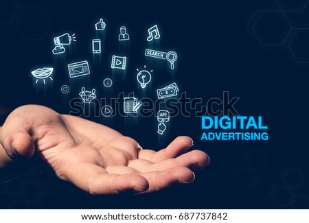 Digital Advertising blue word glowing icon floating over open hand on dark blue background,online payment,Digital marketing concept.