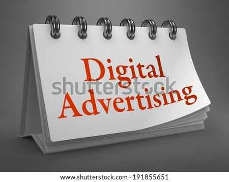 Digital Advertising - Red Inscription on a Desktop Calendar Isolated on Gray Background.