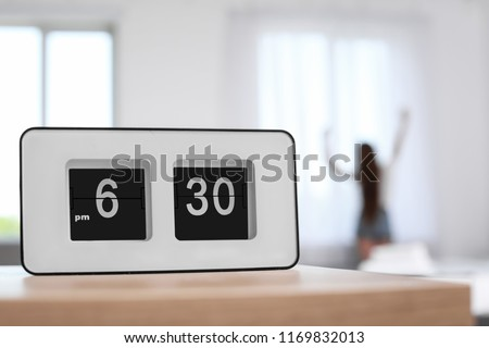 Digital alarm clock on table. Time to wake up