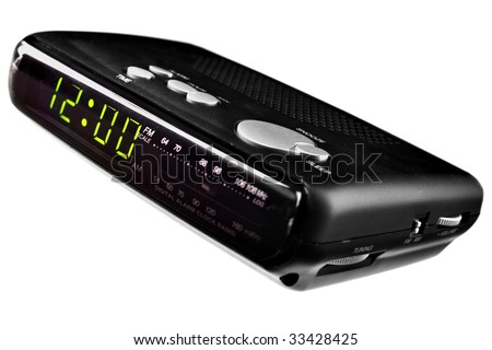 Digital alarm clock radio isolated over white background - stock photo