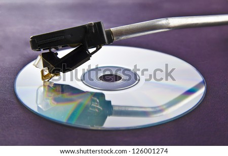 Photo of Digital and Analog turntable playing record.