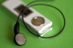 Digital audio player on green background.
