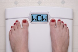 Digital Bathroom Scale Displaying WOW Message