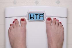 Digital Bathroom Scale Displaying WTF Message
