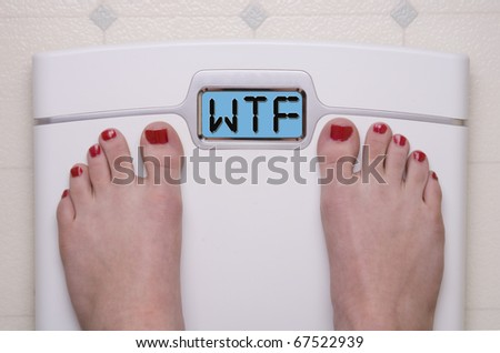 Digital Bathroom Scale Displaying WTF Message