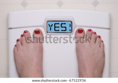 Digital Bathroom Scale Displaying YES Message
