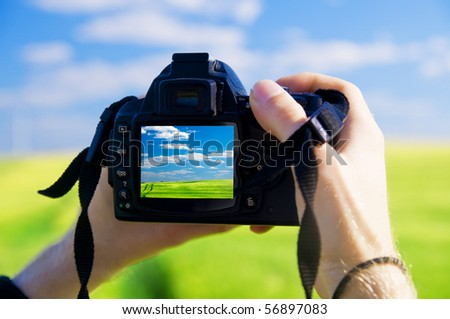 Digital camera capturing beautiful landscape